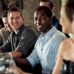 woman-flirting-with-group-of-men-at-bar